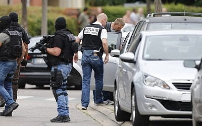 Illustrative: French policemen at the arrest of a man in the Normandy city of Saint-Etienne-du-Rouvray, where an elderly priest was killed by two terrorists who claimed to be acting on behalf of the Islamic State jihadist group, on July 26, 2016. (AFP/Charly Triballeau)