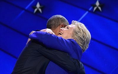 US President Barack Obama (L) hugs US Presidential nominee Hillary Clinton during the third night of the Democratic National Convention at the Wells Fargo Center in Philadelphia, Pennsylvania, July 27, 2016. (AFP PHOTO / Robyn BECK)