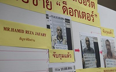 A mugshot of Iranian passport forger 'The Doctor' Hamid Reza Jafary (L) is displayed with his cohorts at the Immigration Detention Center in Bangkok on July 22, 2016. (AFP PHOTO/LILLIAN SUWANRUMPHA)