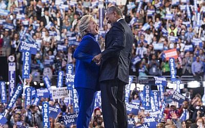 US President Barack Obama is joined by US Democratic presidential candidate Hillary Clinton after his address to the Democratic National Convention at the Wells Fargo Center in Philadelphia, Pennsylvania, July 27, 2016. (AFP/Mandel Ngan)