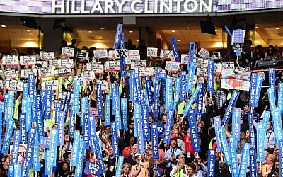 Signs of support for Hillary Clinton and protest signs are seen on the fourth and final day of the Democratic National Convention at the Wells Fargo Center in Philadelphia, Pennsylvania, on July 28, 2016. (AFP/Robyn Beck)