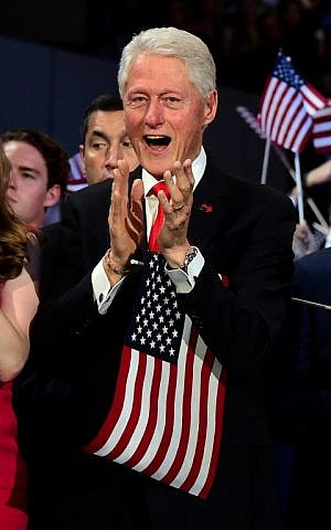 Former US President Bill Clinton applauds as US Democratic Presidential Candidate Hillary Clinton speaks during the final day of the 2016 Democratic National Convention on July 28, 2016, at the Wells Fargo Center in Philadelphia, Pennsylvania. (AFP PHOTO / Robyn BECK)