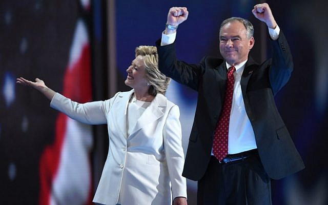 Presidential nominee Hillary Clinton walks with her vice presidential running mate Tim Kaine at the close of the fourth and final day of the Democratic National Convention in Philadelphia on July 28, 2016. (AFP PHOTO/Timothy A. CLARY)