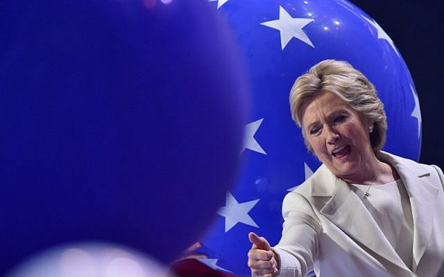 Presidential nominee Hillary Clinton gives a thumbs-up at the end of the fourth and final night of the Democratic National Convention at Wells Fargo Center in Philadelphia on July 28, 2016. (AFP PHOTO/Nicholas Kamm)