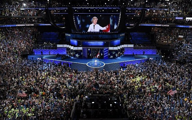 Democratic presidential nominee Hillary Clinton gives a thumbs-up after accepting the nomination during the fourth and final night of the Democratic National Convention at the Wells Fargo Center in Philadelphia on July 28, 2016. (AFP PHOTO/SAUL LOEB)