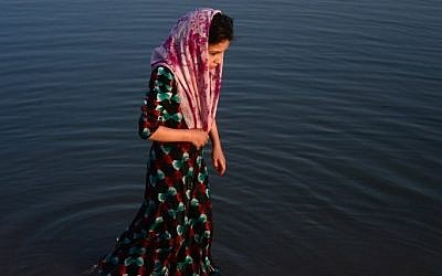 Illustrative: In this photograph taken on July 28, 2016, an Afghan girl stands in the Hari Rud river on the outskirts of Herat. (AFP/Aref Karim)