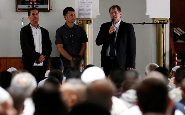 Anouar Kebibech, president of the CFCM (R) talks, as Mohammed Karabila, President of the Muslim Regional Council of Haute-Hormandie and director of the Yahya Mosque in Saint-Etienne-du-Rouvray (L) and Father Pierre in charge of relations with other religions listen on, July 29, 2016. (AFP/Charly Triballeau)