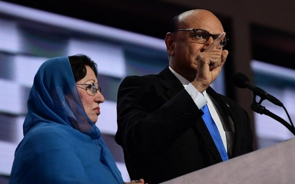 Khizr Khan, right, accompanied by his wife Ghazala Khan, speaks about their son US Army Captain Humayun Khan who was killed by a suicide bomber in Iraq 12 years ago, on the final night of the Democratic National Convention at the Wells Fargo Center, July 28, 2016 in Philadelphia, Pennsylvania. (AFP/Robyn Beck)