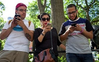 A group of friends play Pokemon Go on their smartphones at Union Square, July 11, 2016 in New York City. (Drew Angerer/Getty Images/AFP)