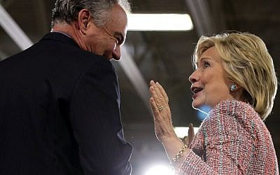 Presumptive Democratic nominee Hillary Clinton (R) and US Sen. Tim Kaine (D-VA) (L) share a moment during a campaign event at Ernst Community Cultural Center at Northern Virginia Community College July 14, 2016 in Annandale, Virginia. (Alex Wong/Getty Images/AFP)