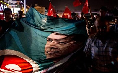 People take to the street in support of President Recep Tayyip Erdogan July 16, 2016 in Antalya, Turkey. Reports have suggested that a group within Turkey's military have attempted to overthrow the government. (Chris McGrath/Getty Images/AFP)