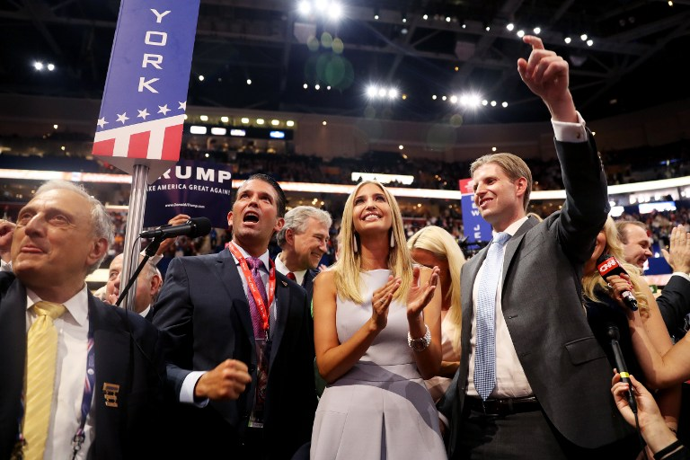 Donald Trump Jr. (2nd-L) along with Ivanka Trump (C) and Eric Trump (R), announce take part in the roll call in support of Republican presidential candidate Donald Trump on the second day of the Republican National Convention on July 19, 2016 at the Quicken Loans Arena in Cleveland, Ohio. ( Joe Raedle/Getty Images/AFP)