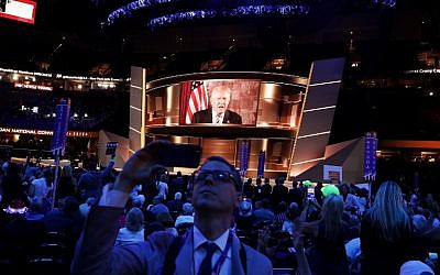 Republican presidential candidate Donald Trump is seen speaking on a screen from New York City, on the second day of the Republican National Convention on July 19, 2016 at the Quicken Loans Arena in Cleveland, Ohio.  (Chip Somodevilla/Getty Images/AFP)