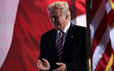 Republican presidential candidate Donald Trump claps after vice presidential candidate Mike Pence delivers his speech on the third day of the Republican National Convention on July 20, 2016 in Cleveland, Ohio. (Win McNamee/Getty Images/AFP)