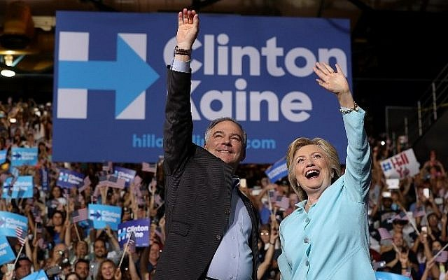 Democratic presidential candidate Hillary Clinton and Democratic vice presidential candidate US Sen. Tim Kaine (D-VA) greet supporters during a campaign rally at Florida International University Panther Arena on July 23, 2016 in Miami, Florida. (Justin Sullivan/Getty Images/AFP)
