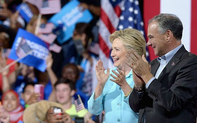 Democratic presidential candidate Hillary Clinton, left and vice presidential candidate Sen. Tim Kaine, D-Virginia, at a campaign rally at Florida International University Panther Arena on July 23, 2016 in Miami, Florida. (Gustavo Caballero/Getty Images/AFP)