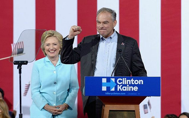 Democratic presidential candidate Hillary Clinton, left, and vice presidential candidate Sen. Tim Kaine (D-Virginia) at a campaign rally at Florida International University Panther Arena on July 23, 2016 in Miami, Florida. (Gustavo Caballero/Getty Images/AFP)