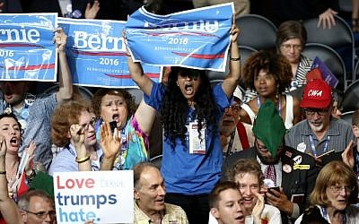 Delegates in support of Sen. Bernie Sanders (I-VT) cheer on the first day of the Democratic National Convention at the Wells Fargo Center, July 25, 2016 in Philadelphia, Pennsylvania. (Win McNamee/Getty Images/AFP)