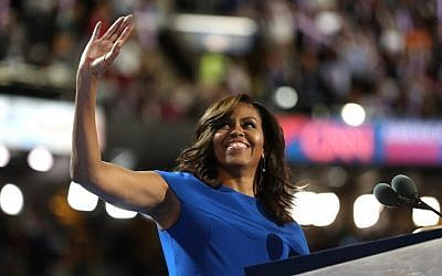 First lady Michelle Obama acknowledges the crowd after delivering remarks on the first day of the Democratic National Convention at the Wells Fargo Center, July 25, 2016 in Philadelphia, Pennsylvania. (Joe Raedle/Getty Images/AFP)