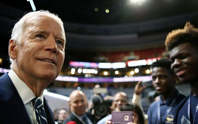 US Vice President Joe Biden talks to students from Eagle Academy for Young Men during a walk through before day two of the Democratic National Convention on July 26, 2016 in Philadelphia, Pennsylvania. (Jessica Kourkounis/Getty Images/AFP)