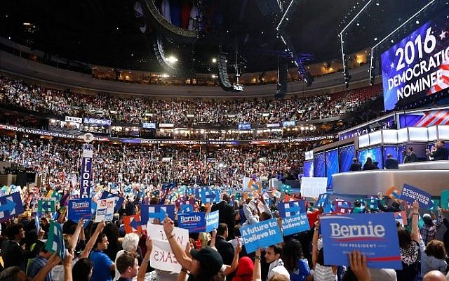 The crowd cheers after formally nominating Democratic presidential candidate Hillary Clinton on the second day of the Democratic National Convention at the Wells Fargo Center, July 26, 2016 in Philadelphia, Pennsylvania. (Aaron P. Bernstein/Getty Images/AFP)