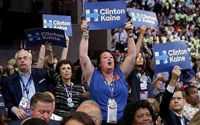 Attendees hold up signs in support of Democratic presidential nominee Hillary Clinton and US Vice President nominee Tim Kaine on the fourth day of the Democratic National Convention at the Wells Fargo Center, July 28, 2016 in Philadelphia, Pennsylvania. (Chip Somodevilla/Getty Images/AFP)