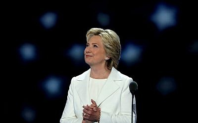 Democratic presidential nominee Hillary Clinton acknowledges the crowd as she arrives on stage during the fourth day of the Democratic National Convention at the Wells Fargo Center in Philadelphia on July 28, 2016. (Alex Wong/Getty Images/AFP)