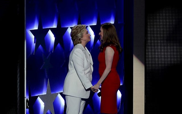 Democratic presidential nominee Hillary Clinton embraces her daughter Chelsea Clinton after being introduced on the fourth and final day of the Democratic National Convention at the Wells Fargo Center in Philadelphia, Pennsylvania on July 28, 2016. (Alex Wong/Getty Images/AFP)