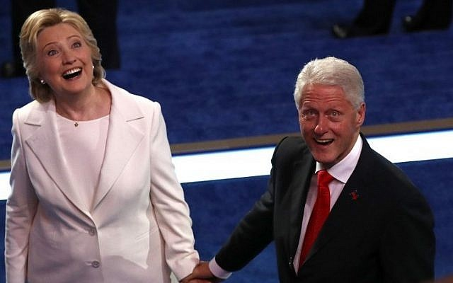 Presidential nominee Hillary Clinton and her husband, former US president Bill Clinton, acknowledge the crowd at the end of the fourth day of the Democratic National Convention at the Wells Fargo Center in Philadelphia on July 28, 2016. (Win McNamee/Getty Images/AFP)