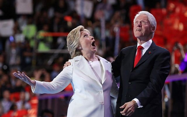 Democratic presidential nominee Hillary Clinton and her husband, former US president Bill Clinton, acknowledge the crowd at the end of the fourth day of the party's convention in Philadelphia on July 28, 2016. (Chip Somodevilla/Getty Images/AFP)