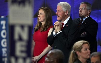 Chelsea Clinton and former US president Bill Clinton watch as Hillary Clinton speaks on the fourth day of the Democratic National Convention at the Wells Fargo Center in Philadelphia on July 28, 2016. (Alex Wong/Getty Images/AFP)