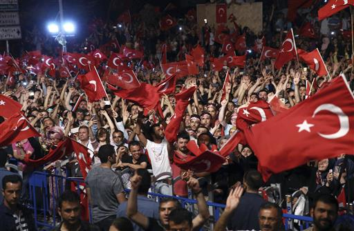 Supporters listen to Turkey's President Recep Tayyip Erdogan as he addresses them in front of his residence in Istanbul, early Tuesday, July 19, 2016. (Kayhan Ozer/Pool Photo via AP)