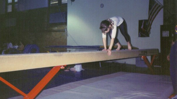 A young Dvora Meyers on the beam. (Courtesy)