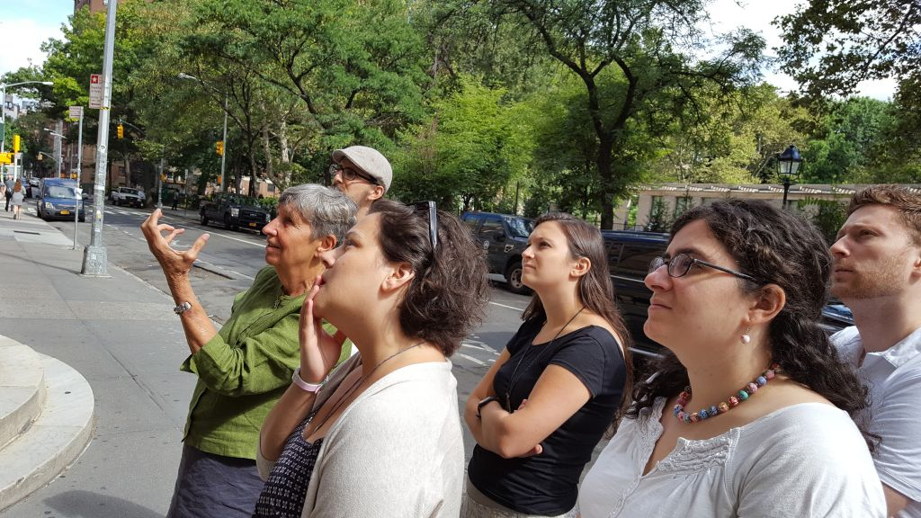 Reverend Donna Schaper showing the fellows the outside of Judson Memorial Church, where she is the senior pastor. (Courtesy)