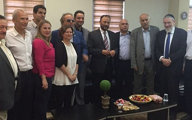 Former Saudi general Dr. Anwar Eshki (center, in striped tie) and other members of his delegation, meet with Israeli Knesset members and others during a visit to Israel on July 22, 2016. (via Twitter)