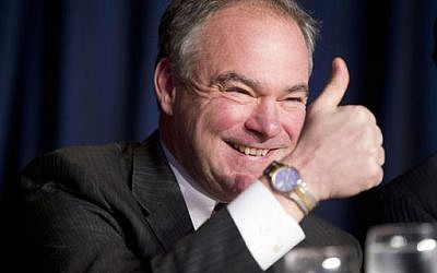 In this Feb. 4, 2016 photo, Sen. Tim Kaine, D-Va., gives a 'thumbs-up' as he takes his seat at the head table for the National Prayer Breakfast in Washington. (AP Photo/Pablo Martinez Monsivais, File)
