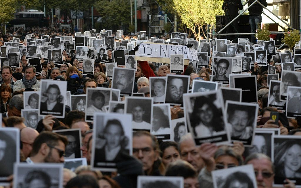 Participants hold photos of some of the 85 victims at a memorial ceremony on the 22nd anniversary of the AMIA Jewish center bombing in Buenos Aires on July 18, 2016. (Photo by Leonardo Kremenchuzky, courtesy of AMIA/Via JTA)
