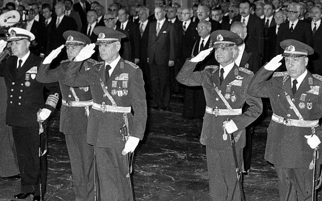 In this Oct. 29, 1980 photo, the leaders of Sept. 12 military coup, from left to right, Adm. Nejat Tumer, Gen. Nurettin Ersin, Gen. Kenan Evren, Gen. Tahsin Sahinkaya and Gen. Sedat Celasun stand during a ceremony at the mausoleum of the founder of modern Turkey, Kemal Ataturk, in Ankara, Turkey. (AP Photo/Burhan Ozbilici, File)