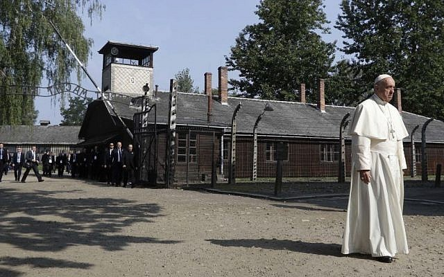 Pope Francis walks through the gate of the former Nazi German death camp of Auschwitz in Oswiecim, Poland, Friday, July 29, 2016. (AP/Gregorio Borgia)