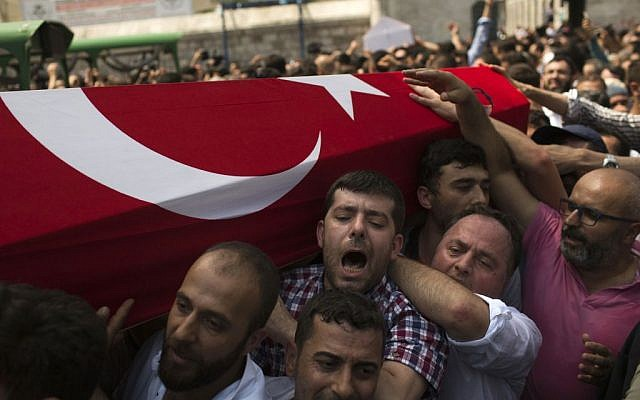 Mourners at a funeral carry the coffin of a person killed Friday while protesting against the attempted coup against Turkey's government, in Istanbul, Sunday, July 17, 2016. (AP Photo/Emilio Morenatti)