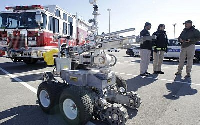 A robot bomb disposal vehicle is seen in Arlington, Texas during a public safety agencies media day in 2011  (AP Photo/Tony Gutierrez)