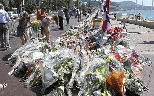 Flowers and messages placed along the Promenade des Anglais in Nice on July 20, 2016, to honor the victims of the Bastille Day truck attack. (AP Photo/Claude Paris)