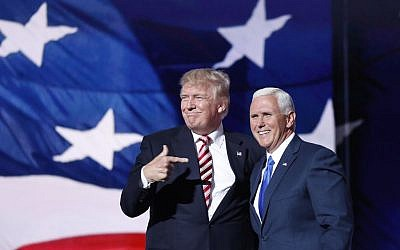 Republican presidential candidate Donald Trump points toward running mate Indiana Gov. Mike Pence after Pence's acceptance speech during the third day of the Republican National Convention in Cleveland, Ohio, Wednesday, July 20, 2016. (AP Photo/Mary Altaffer)
