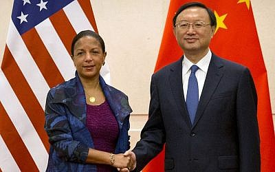 U.S. National Security Adviser Susan Rice, left, and Chinese State Councilor Yang Jiechi, right, shake hands as they pose for a photo at the Diaoyutai State Guesthouse in Beijing, Monday, July 25, 2016. (AP Photo/Mark Schiefelbein, Pool)