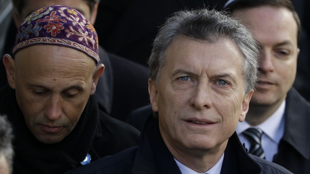 Argentine President Mauricio Macri arrives for the 22nd anniversary event for the AMIA Jewish center bombing that killed 85 people in Buenos Aires, Argentina, July 18, 2016. To his left is Sergio Bergman. (AP Photo/Natacha Pisarenko)