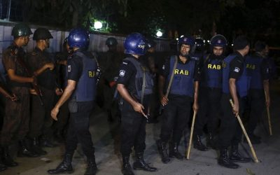 Bangladeshi security personnel cordon off the area after a group of gunmen attacked a restaurant popular with foreigners in a diplomatic zone of the Bangladeshi capital Dhaka, Bangladesh, Friday, July 1, 2016.  (AP Photo)
