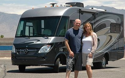 Brad and Amy Herzog posing in front of an RV in 2012 (Courtesy Brad Herzog)