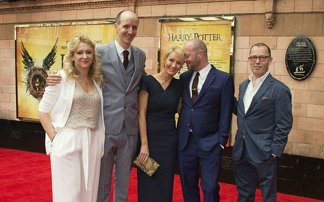 From left to right, producer Sonia Friedman, writers Jack Thorne, author J.K. Rowling, director John Tiffany and Sir Colin Callender, pose for photographers on arrival at the gala performance of Harry Potter and the Cursed Child, at the Palace Theatre in central London, Saturday, July 30, 2016. (Joel Ryan/Invision/AP)
