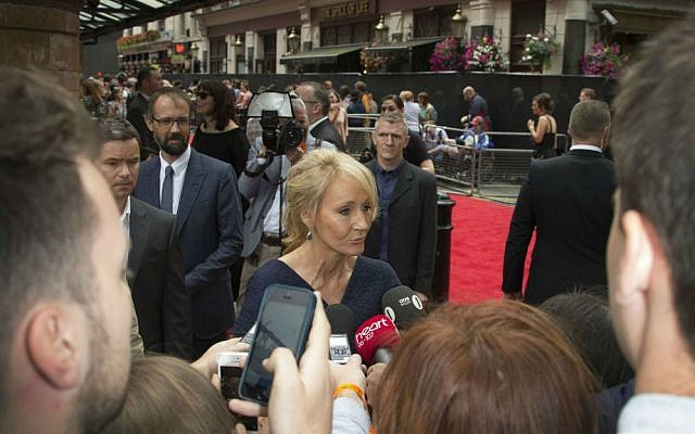 Writer J.K. Rowling talks to media on arrival at the gala performance of Harry Potter and the Cursed Child, at the Palace Theatre in central London, Saturday, July 30, 2016. (Joel Ryan/Invision/AP)