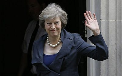 Britain's Home Secretary Theresa May waves towards the media as she arrives to attend a cabinet meeting at 10 Downing Street, in London, Tuesday, July 12, 2016. Theresa May will become Britain's new Prime Minister on Wednesday. (AP Photo/Kirsty Wigglesworth)